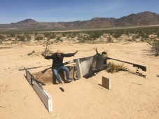 "Peter Noever at the tracks of Alfredo Barsuglia's ""Social Pool"" in the Californian desert (Photo: Elisabeth Noever-Ginthör)"